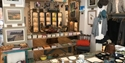 Interior shot at Greenfinch shop in Ticehurst, East Sussex, showing paintings, ceramics, clothes and gifts