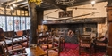 Fireplace and lounge at The Mermaid Inn, Rye
