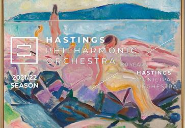 a poster with a colourful oil painting background  over a lady sat on a pink beach.  White writing overlaying says Hastings Philharmonic Orchestra.