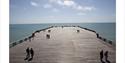 People walking on the pier head at Hastings Pier © Georgie Scott