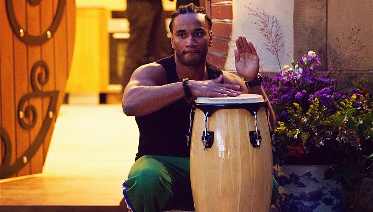 Musician plays Brazilian music on a drum