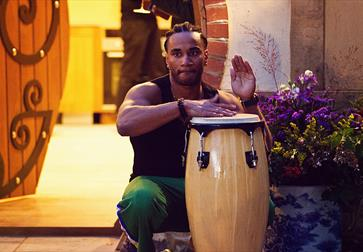 Musician plays Brazilian music on a drum