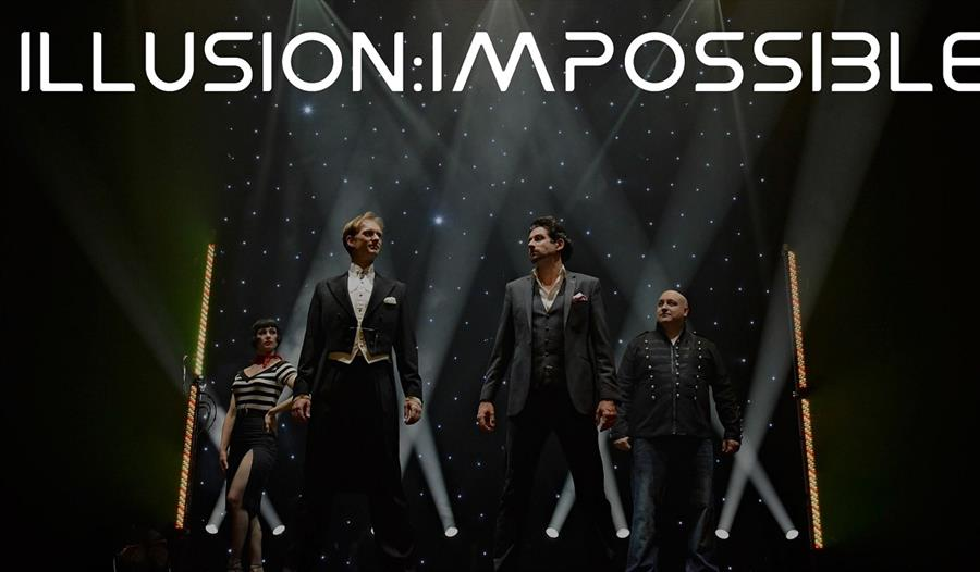 A post for illusion impossible. Men in suits standing on a stage.