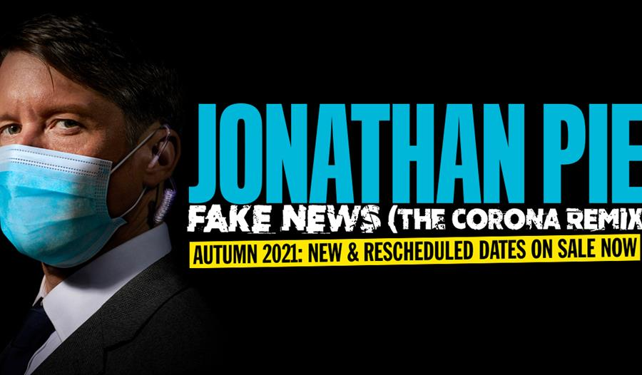 poster for Jonathan Pie at White Rock Theatre. Black background. White man in suit and blue face mask stands to left. Text says Jonathan Pie, Fake New