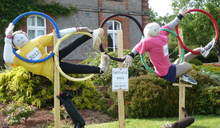 Scarecrows in Olympic hoops at Battle Scarecrow Festival