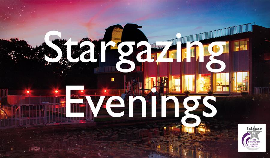 a photogrpah of a building at sunset, with orange lights in the building and blue and pink sky. Obstructed by large with letters that say Stargazing E