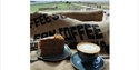 coffee and cake on a coffee bean sack, overlooking rye harbour nature reserve.