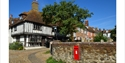 Timber framed house and postbox