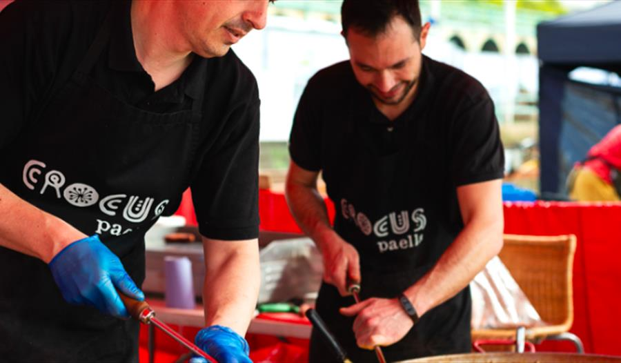 two chefs wearing black crocus paella t-shirts. For the hub bodiam food event, rother