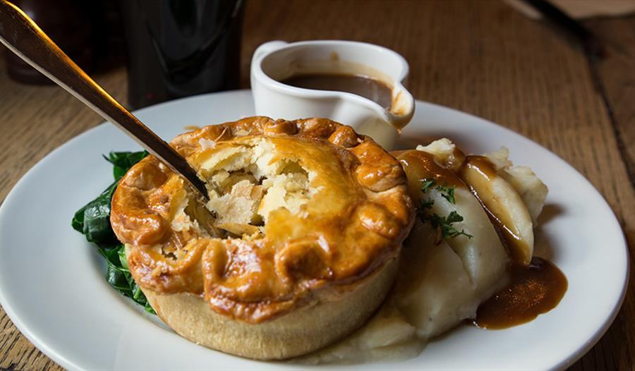 Pie, mash ad gravy on plate, Browns Pie Shop, Lincoln.
