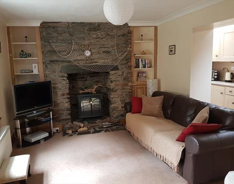 Living room with original stone fireplace.
