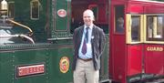 Blue-badge guide Chris Callow with vintage IMR locomotive No 13 Kissack