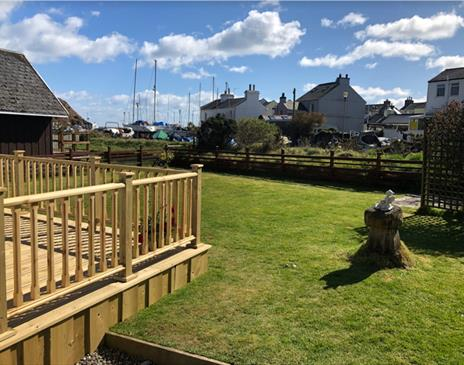 Outside view looking across the garden to the harbour