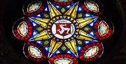 Three Legs of Mann Stained Glass Window