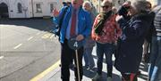 Wild Mann Tours guiding cruise ship visitors in Castletown.