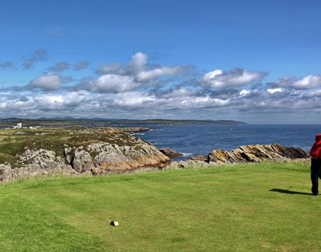 Golfing on one of the Island's coastal courses