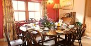 B&B guests enjoy discussions round the lovely communal dining table at Knockaloe Beg Isle of Man is produce served whenever possible