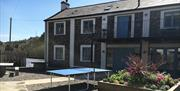 Salmon River Apartments Garden with Table Tennis Table out.