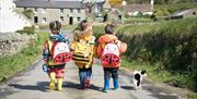 Children wearing the Bee Explorer Bags at Cregneash