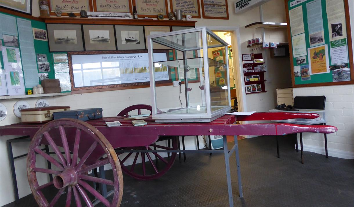 Inside the Museum and an original cart to carry the luggage of visitors to their hotels around Douglas Bay