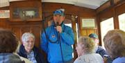 Blue-badge Guide Chris Callow commentating on the ride to the summit of Snaefell mountain aboard a vintage tram-car