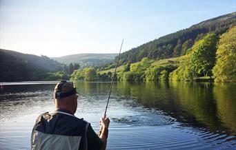 Landing a fish at West Baldwin. Photo courtesy of Geoff Thomas.