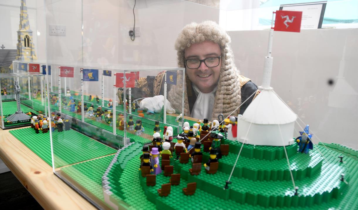 Speaker of the House of Keys inspecting the custom-built Lego model of Tynwald Day