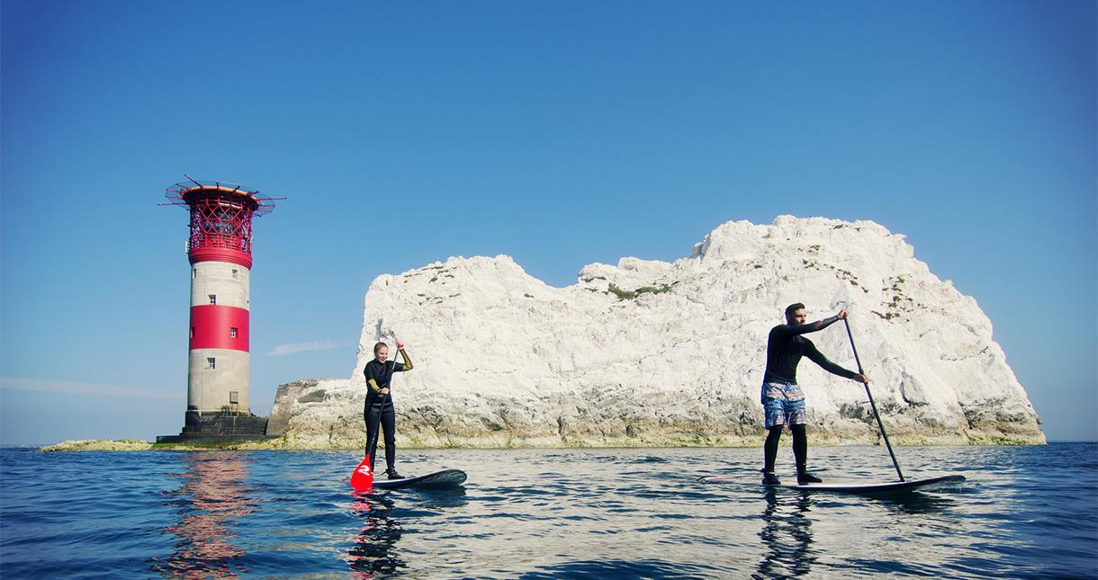 Stand Up Paddleboarders at The Needles