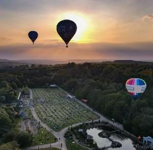 Credit - IOWightDrone - hot air balloons floating above Robin Hill