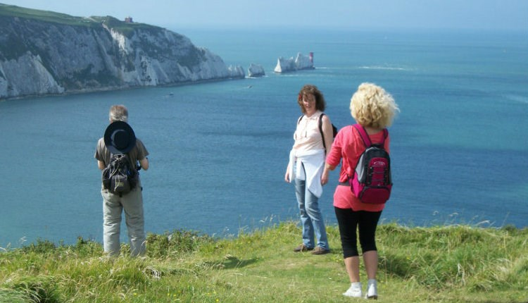 Group standing on cliff with The Needles in the background, Isle of Wight Guided Tours, Things to Do