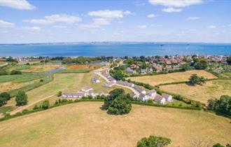 Isle of Wight, Accommodation, Seaview Holidays, image showing aerial view of Holiday cottages and views to sea.