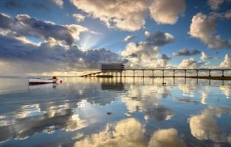 Clouds reflecting on the sea next to Bembridge lifeboat station, Bembridge Lane End Beach, Isle of Wight, Things to Do