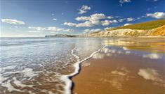 Sunny day with few clouds in the sky over Compton Beach, Isle of Wight, Things to Do