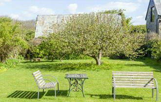 Outside garden area with benches at Gotten Manor - Self-catering & B&B - Isle of Wight