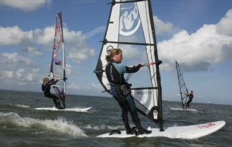 Lady windsurfing, Tackt-Isle Adventures, Isle of Wight, Things to Do
