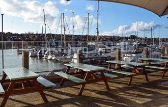 Outside seating on decking overlooking the marina at The Lifeboat, East Cowes, local produce, let's buy local