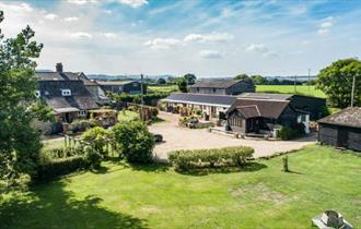 Aerial view of Middle Barn Farm with rolling countryside, self-catering, Isle of Wight