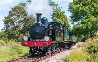 Steam train on tracks surrounded by countryside, Isle of Wight Steam Railway, Things to Do, Isle of Wight