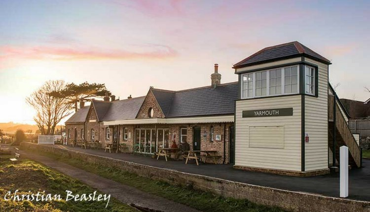 Sunset, outside view of Off The Rails Yarmouth, Isle of Wight, restaurant