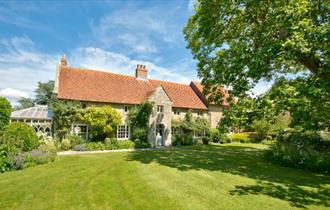 Outside view of Shalfleet Manor from garden, self-catering, Isle of Wight
