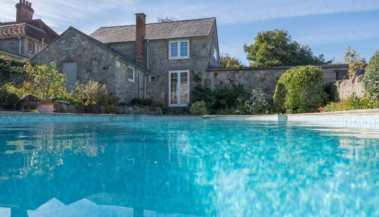 Outside swimming pool at Sunset Cottage, Isle of Wight, Self Catering