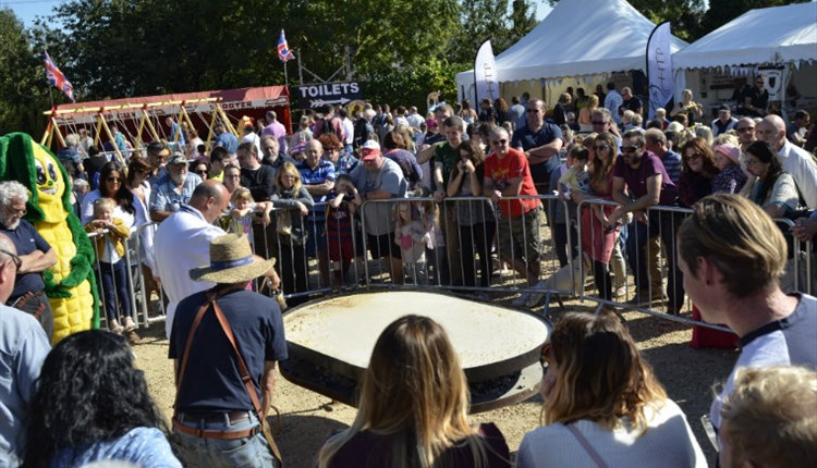Isle of Wight, Things to Do, Sweetcorn Fayre at Arrenton Barns, Image of giant corn fritter being prepared with large crowd gathering