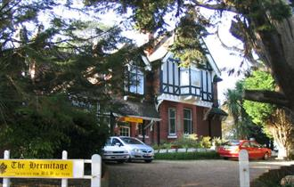 Front view of The Hermitage B&B and the driveway in front of B&B, bed and breakfast, Isle of Wight.