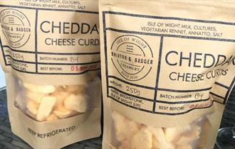 Image of bags of Cheddar Cheese Curds, Local produce, Brixton and Badger, Brighstone, Isle of Wight.