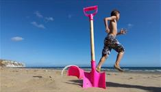 Boy next to bucket and spade on Yaverland Beach, Sandown, Isle of Wight, Things to Do