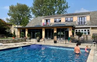 Apartments and The Core Complex overlooking the outdoor swimming pool at Appuldurcombe Gardens Holiday Park, Self catering, Isle of Wight
