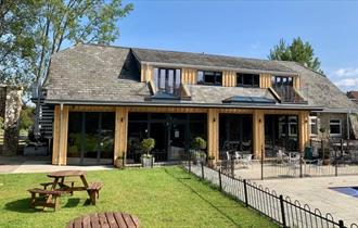 Outside view of The Core Cafe and yoga and pilates studio opposite the swimming pool at Appuldurcombe Gardens Holiday Park, Isle of Wight, holiday par