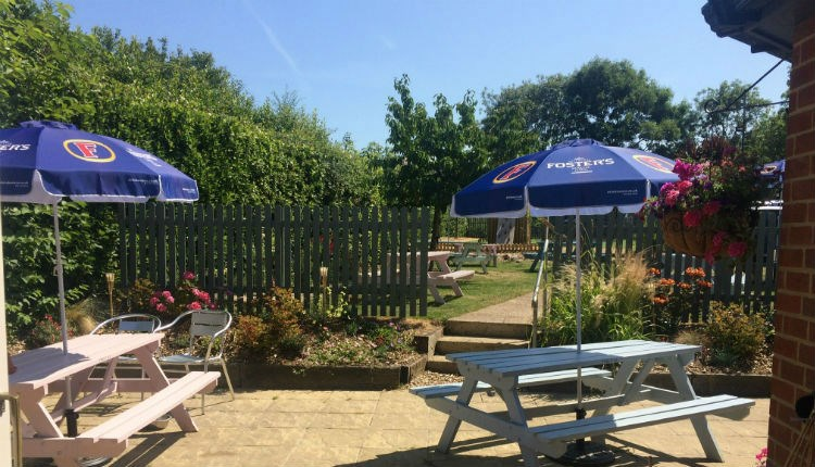 Outside view of garden with outside seating at The Fleming Arms, Binstead, local produce, let's buy local