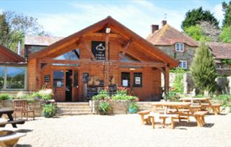 Outside view of The Garlic Farm shop with outside seating, Isle of Wight, local produce, let's buy local
