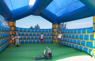 Children playing on a bouncy castle in the grounds of the Horse & Groom, eating out, local produce, Isle of Wight